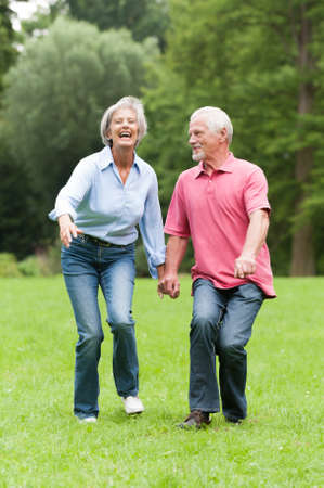 retiree: Active senior couple in the park
