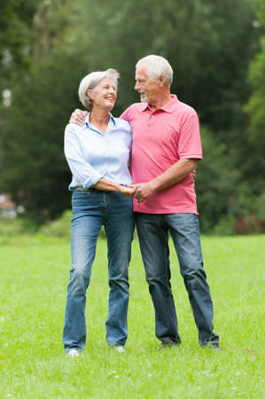red jeans: Happy and smiling senior couple in love Stock Photo