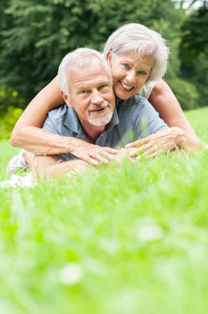 Happy and smiling senior couple in love photo