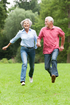Active senior couple in the park Stock Photo - 14904251