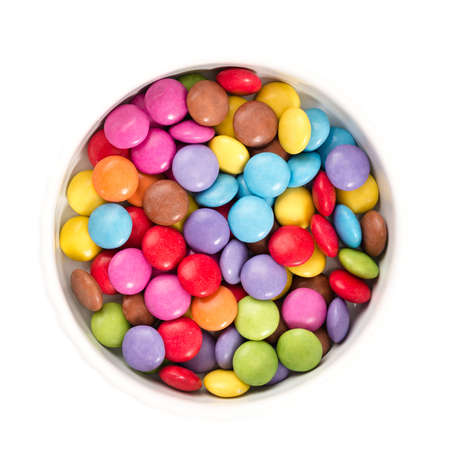 Colorful chocolate in front of white background photo