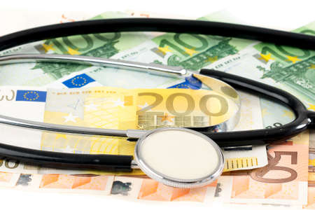 medical bill: Euro banknotes with stethoskop in front of white background Stock Photo