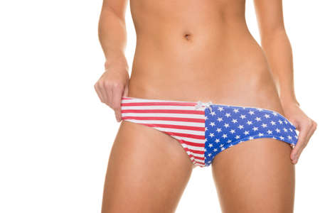 pink bikini: Young woman with usa lingerie in front of white background