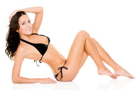 black bra: Woman with black bikini sitting in the studio