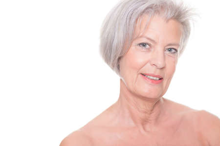 Portrait from a senior woman in front of white background photo
