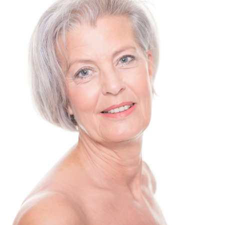 Portrait from a senior woman in front of white background Imagens