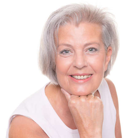 senior woman: Smiling senior woman in front of white background