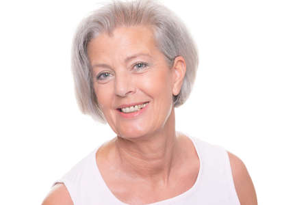 woman mature: Smiling senior woman in front of white background