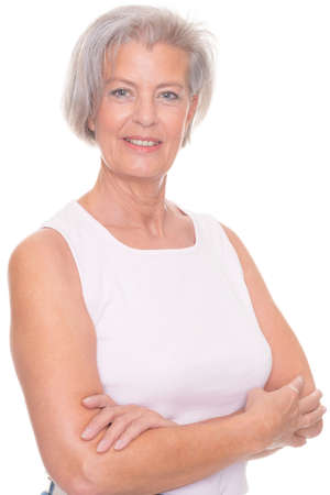 older person: Smiling senior woman in front of white background