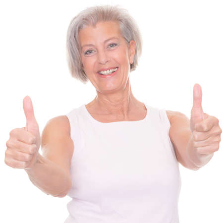Smiling senior woman in front of white background photo
