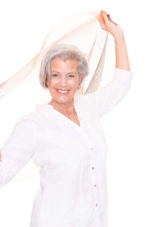 Senior woman with scarf in front of white background