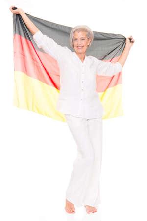 soccer fan: German senior soccer fan in front of white background
