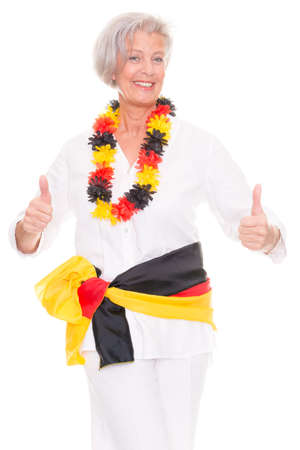German senior soccer fan in front of white background photo