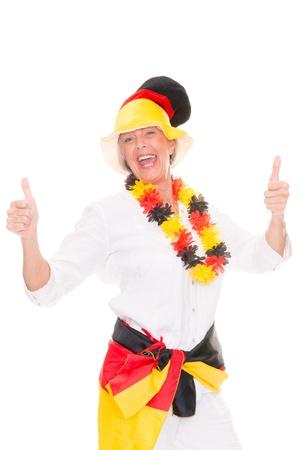 colour fan: German senior soccer fan in front of white background