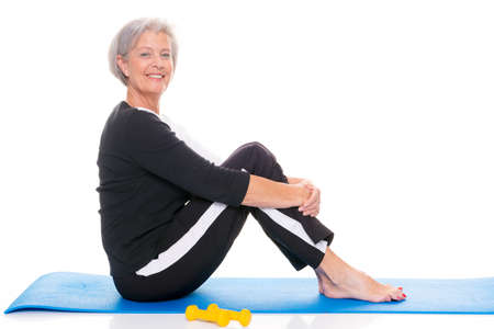 Active senior woman at workout in front of white background