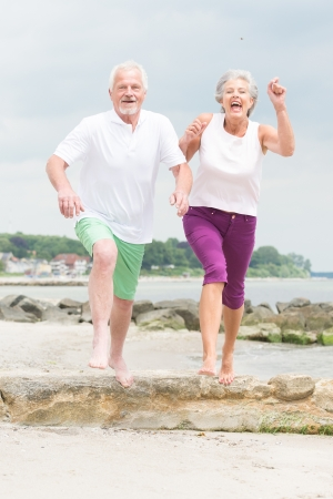 Active and sporty senior couple at the beach Reklamní fotografie - 20600068