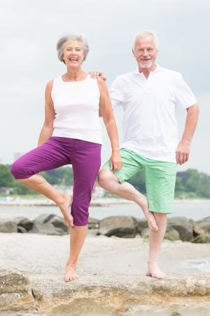Active and sporty senior couple at the beach Reklamní fotografie - 20600061