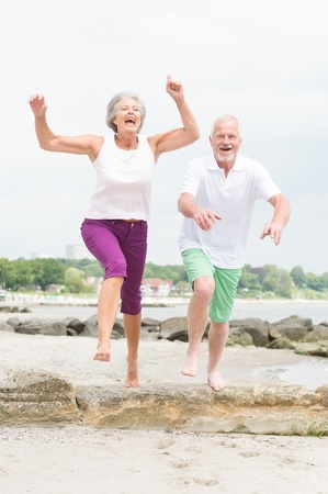 Active and sporty senior couple at the beach