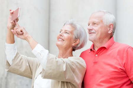 Smiling senior couple make a selfie Reklamní fotografie