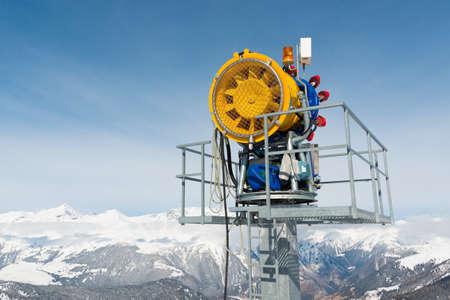 Snow machine in front of blue sky Reklamní fotografie
