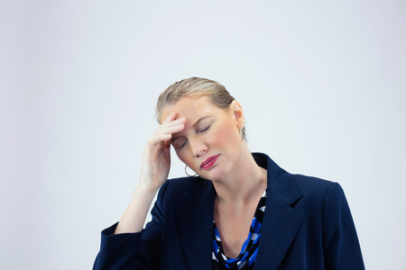head pain: Closeup of Business Woman With Head Pain