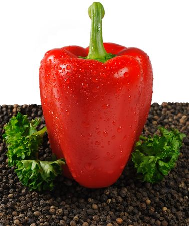 Red paprika with black pepper and parsley isolated on white Stock Photo