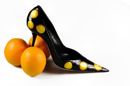Women shoe with three oranges isolated on white Stock Photo