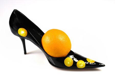 Women shoe with orange isolated on white
