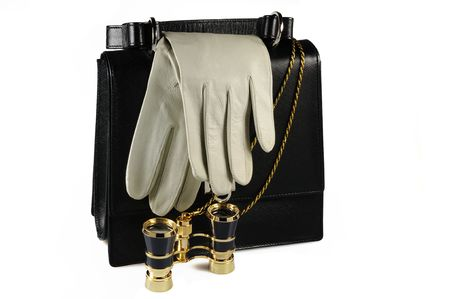 Evening woman bag with pair of leather gloves and opera glasses Stock Photo