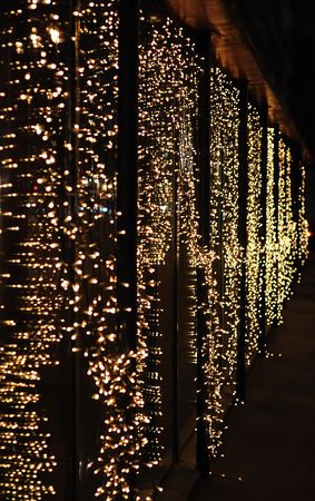 The glass wall is decorated with electric lights