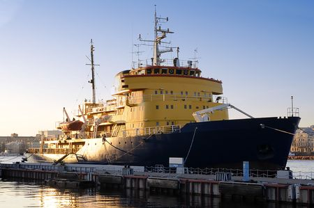 Icebreaker moored at the pier at sunset