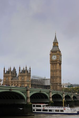 Clock Tower (Big Ben), House of Parlament and Westminster Bridge spanning the river Thames in the autumn day
