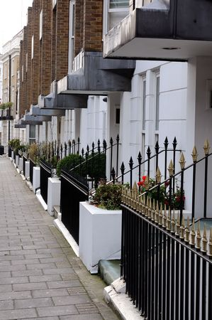 A row of white edwardian houses in a London street Stock Photo