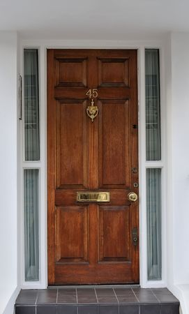 Luxury wooden door to appartment in London photo