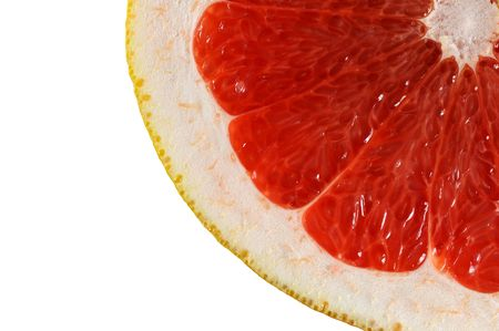 Macro view slice of grapefruit isolated on white