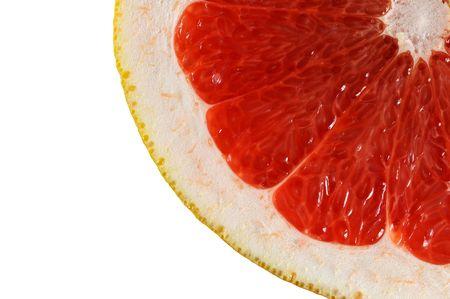 Macro view slice of grapefruit isolated on white