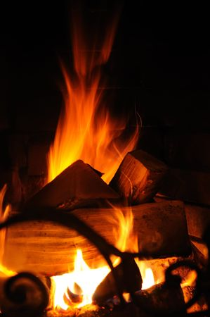 Flames burning wood in a fireplace Stock Photo