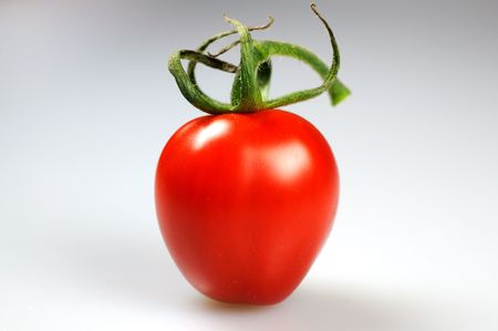 A ripe red cherry tomato