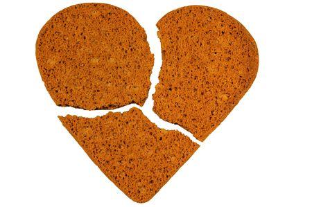 Broken heart cookies isolated on white. Stock Photo