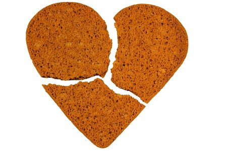 Broken heart cookies isolated on white. Stock Photo