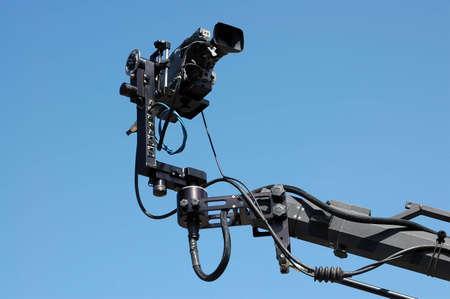 jib: camera on crane or jib, blue sky on background
