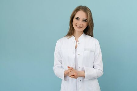 Positive emotions doctor woman on a blue background