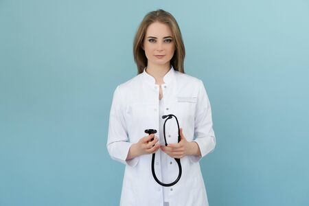 Doctor woman holding a stethoscope
