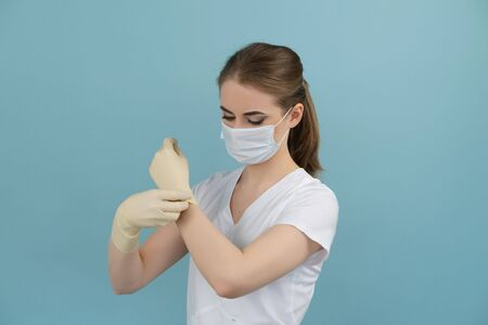 doctor puts on rubber gloves for surgery