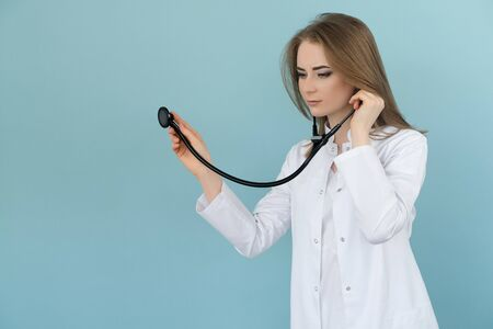 Doctor woman with stethoscope on a blue background