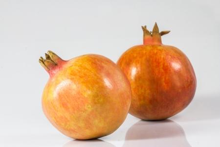 Two pomegranates on a white background  photo