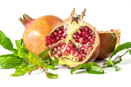 Two pomegranates on a white background  photo