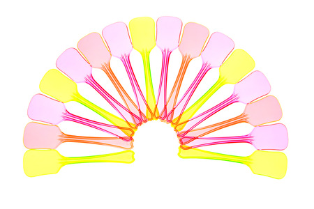 baby cutlery: Colorful plastic spoons arranged in a fan. Stock Photo