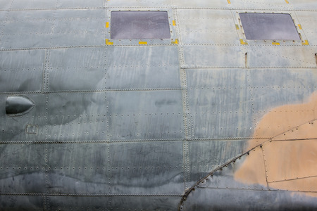 aircraft rivets: Dirty texture of old plane body Stock Photo