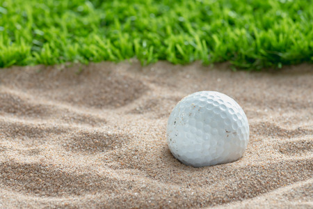bunker: Golf ball in sand bunker